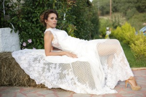 Calliope Anemouli wedding dress white lay on wheat